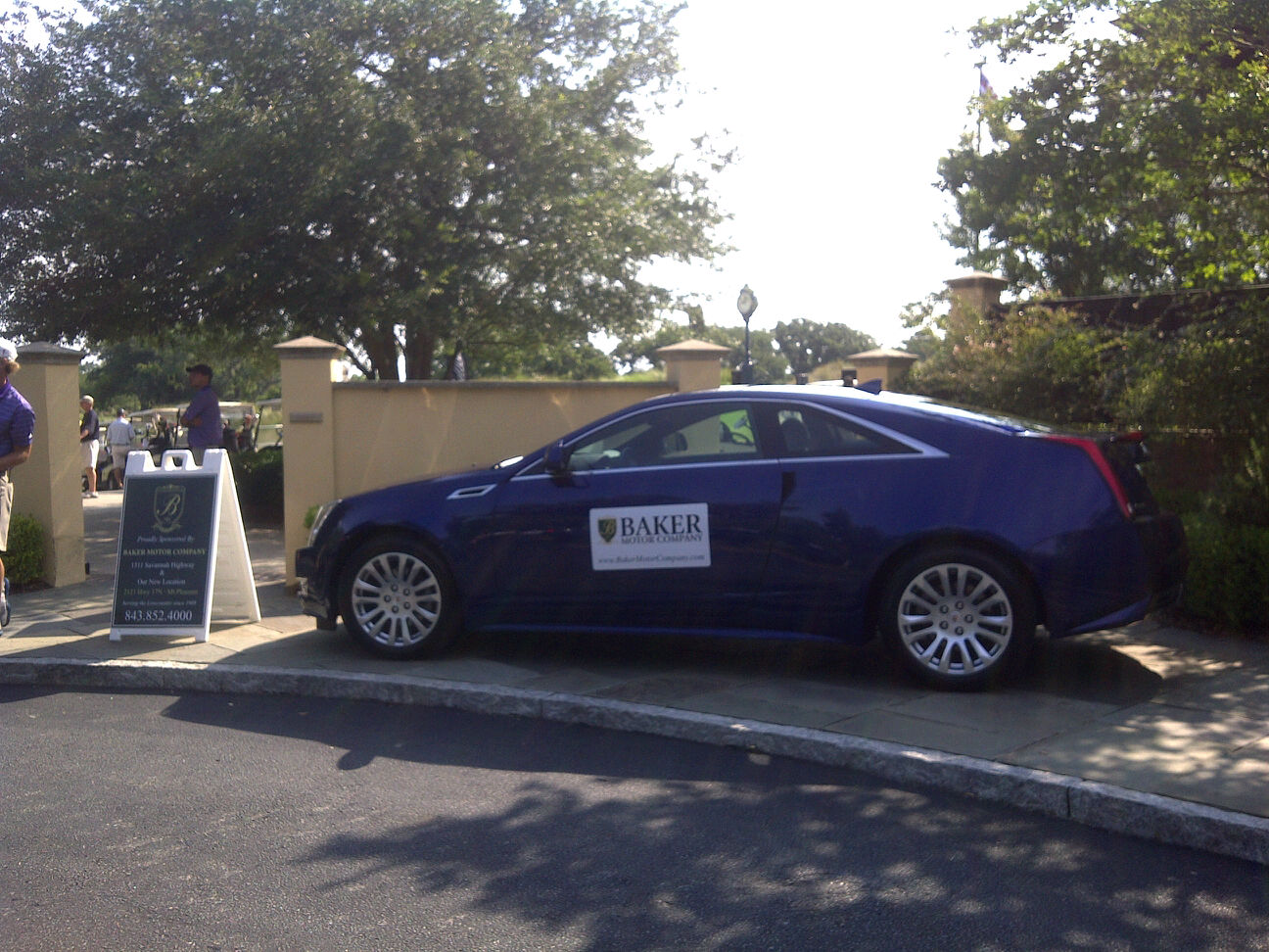Baker cadillac vehicles take to the green for the national for Baker motors mt pleasant